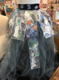 Dress made and adorned with recycled materials